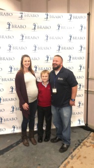 Kevin Hennessey, pictured right with wife Heather and son Aidan.